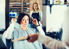 Upset woman in hairdress salon Royalty Free Stock Images