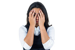 Upset woman with hands over her eyes. Against a white background royalty free stock photo