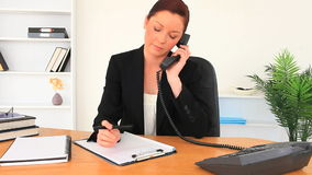 Upset woman having a phone conversation. At her office stock video footage