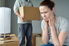 Upset woman when her partner is move out from home. Upset women (age 30-40) when her partner is move out from home. Moving house concept. Real people. copy space Stock Image
