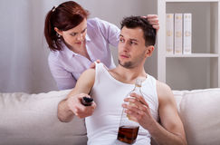 Upset woman and her partner. Woman is upset about her partner's laziness royalty free stock photos