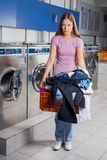 Upset Woman Holding Basket Full Of Dirty Clothes Stock Image