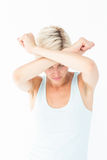 Upset woman holding her arms in front of her head Stock Image