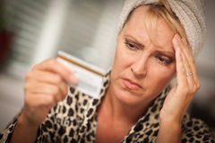 Upset Woman Holding Her Credit Card Stock Images