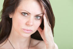 Upset Woman Holds Head Stock Photo