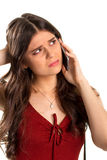 Upset woman holds a phone. Royalty Free Stock Photos