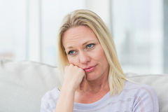 Upset woman in living room Stock Image