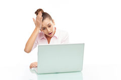 Upset woman looking at her laptop Royalty Free Stock Photos