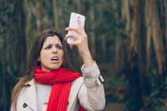 Upset woman looking smartphone royalty free stock image