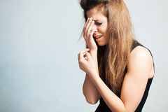 The upset woman loudly cries Royalty Free Stock Image