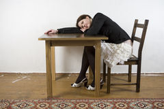 Upset woman lying on table. Stock Images