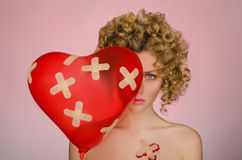 Upset woman with patches on the body and balloon Royalty Free Stock Photography
