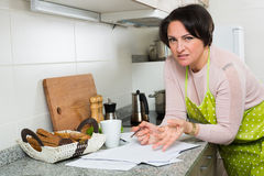 Upset woman reading bank documents Royalty Free Stock Image