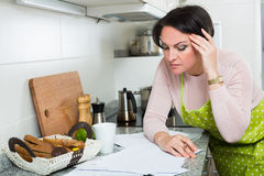 Upset woman reading bank documents Stock Image