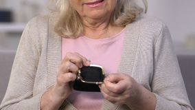 Upset woman showing empty purse, retirement poverty, financial crisis, credit. Stock footage stock video footage