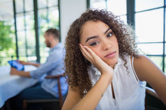 Upset woman sitting in a restaurant Royalty Free Stock Photography