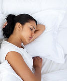 Upset woman sleeping separately of her husband Royalty Free Stock Photo