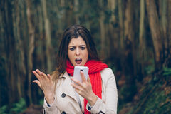Upset woman with smartphone stock photo