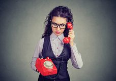 Upset woman speaking on telephone royalty free stock images