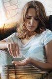Upset woman taking pills Royalty Free Stock Photo