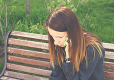 Upset woman talking on the mobile phone Royalty Free Stock Photos
