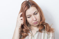 Upset woman thinking Stock Photography