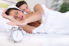 Upset woman turn off alarm clock Royalty Free Stock Images