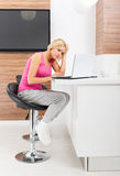 Upset woman using laptop unhappy negative emotion Stock Photo