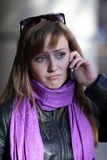 Upset woman witn mobile phone Stock Image