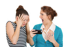 Upset women on mobile cell phone Royalty Free Stock Photo