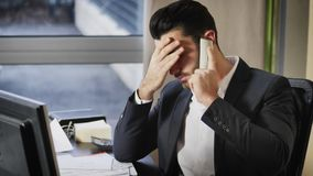 Upset, worried business on phone in office Royalty Free Stock Photography