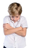 Upset young boy with crossed arms Royalty Free Stock Photo