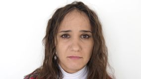 Upset young brunette woman portrait on white background. Sad woman with negative emotion. slow motion. 3840x2160 stock video
