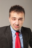 Upset young business man Royalty Free Stock Photography
