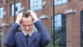 Upset Young Businessman with Headache and Frustration of FAilureh. Upset Young Businessman with Headache and Frustration of Failure, Creative designer stock video