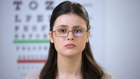 Upset young female in broken eyeglasses looking to camera, suffering bullying. Stock footage stock video