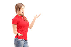 Upset young female trying to give explanation Royalty Free Stock Photos