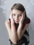 Upset young girl. A portrait of a young girl with a sad look on her face Stock Images
