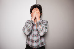 Upset young man against dual colored background Royalty Free Stock Images