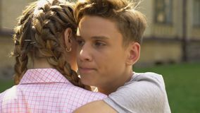Upset young man embracing teen girlfriend, relationship crisis, difficulties. Stock footage stock video