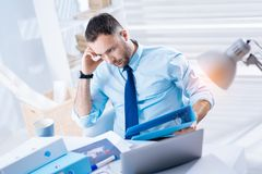 Upset young man looking gloomy after losing his favorite job Royalty Free Stock Images