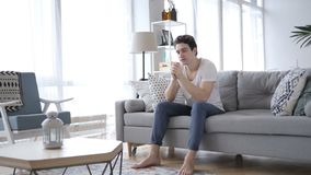 Upset Young Man in Tension Sitting on Sofa and Thinking. 4k , high quality stock video