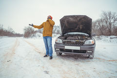 Upset young men look under the hood and call service Stock Photography