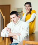 Upset  young ordinary man against  depressed woman  at home Stock Photography