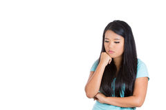 An upset young teenager with her fist on chin Stock Images