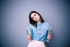 Upset young woman holding two glass of champagne Stock Photo
