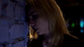 Upset young woman leaning at wall, suffering after break-up, depression, closeup. Stock photo royalty free stock photos