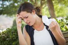 Upset Young Woman with Pencil and Crumpled Paper in Hand royalty free stock photography