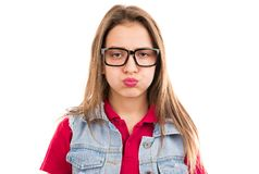 Upset young woman puffing cheeks. Young grumpy woman in glasses looking unhappy and puffing cheeks in disagreement isolated on white background stock image