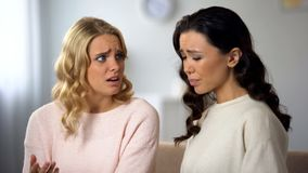 Upset young woman telling best friend about her boyfriend betrayal, compassion. Upset young women telling best friend about her boyfriend betrayal, compassion royalty free stock image